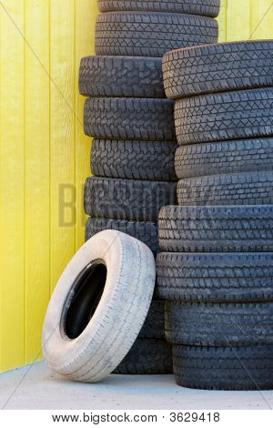 Tires Against Yellow Wall