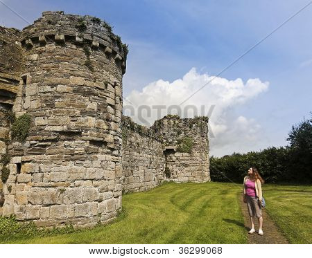 A Woman Gazes At Beaumaris Castle On Anglesey