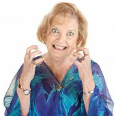 foto of outrageous  - Restless European senior female with clenched teeth - JPG