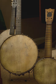 stock photo of musical instrument string  - Detail view of collection of antique banjos natural lighting - JPG