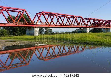 Red bridge over Mures river, Romania