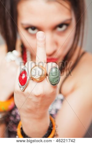 Young girl showing middle finger, rude and offensive gesture