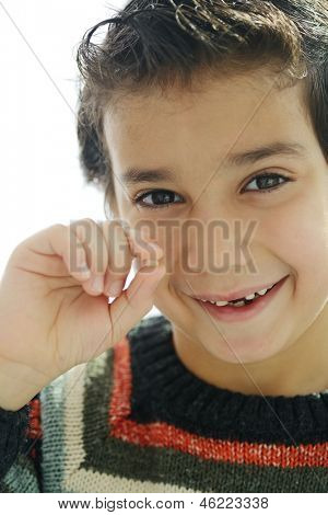 Portrait of cute kid losing his first tooth