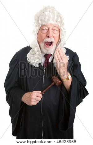 Britiish style judge wearing a wig, bored and yawning.  Isolated.