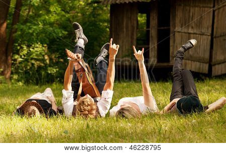 Four Friends Lying In Grass