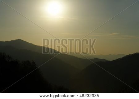 Defused Sun Over Blue-green Mountains