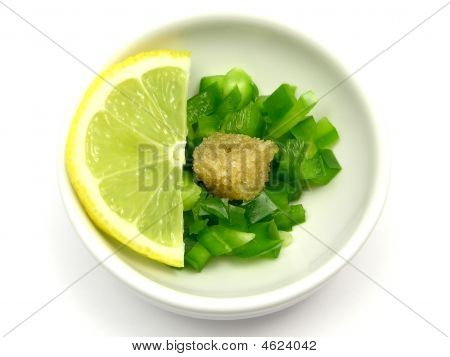 Dices Of Green  Pepper With Sugar And Lemon In A Little Bowl Of Chinaware