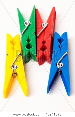 Closeup image of colorful clothespins isolated on a white background