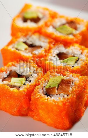 California Maki Sushi with Masago  - Roll made of Fresh Raw Salmon, Avocado, Japanese Mayonnaise inside and Masago (smelt roe) outside