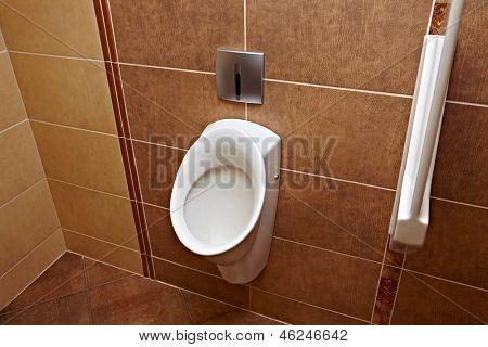 Mens toilet urinals in a public restroom