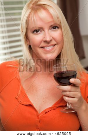 Sultry Blond With A Glass Of Wine