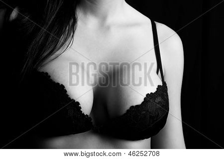 Close up of a woman's breasts wearing a bra