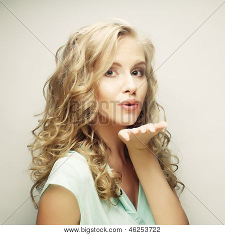 Attractive beautiful woman showing air kiss