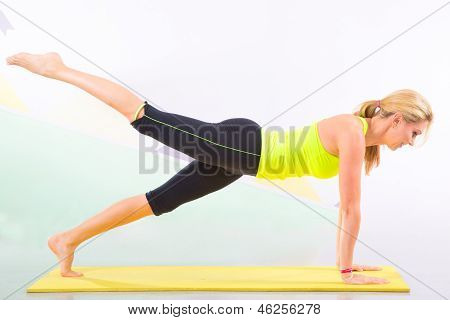 Beautiful Pilates Instructor With Yellow Yoga Mat