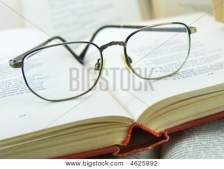 Books And Glasses On It