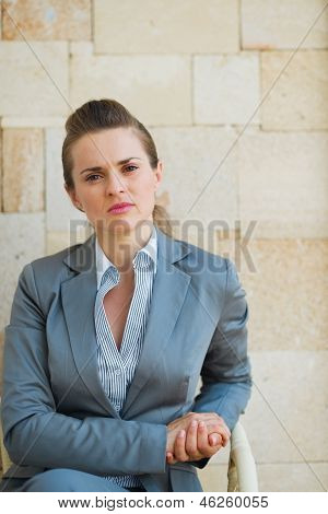 Confident Business Woman Sitting On Terrace