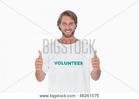 Happy man wearing volunteer t-shirt giving thumbs up on white background