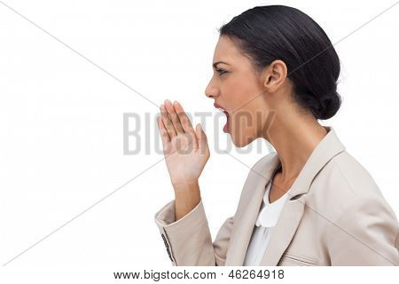 Profile view of a businesswoman calling for someone on white background