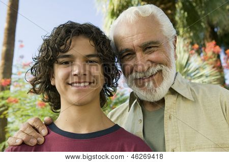 Boy (13-15) with Grandfather outdoors front view portrait.