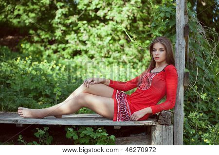 Beautiful Girl In The Dress Is Relaxed