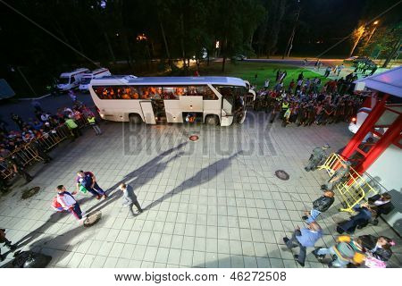 MOSCOW - AUG 15: Fans are watching as players get on bus after match between Russia national team and Ivory Coast at Lokomotiv Stadium, Aug 15, 2012, Moscow, Russia. The game ended with the score 1:1