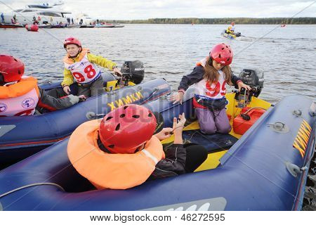 MOSCOW - SEP 29: Children in inflatable boats at Powerboat Race Show 2012 in yacht club Gals, Sep 29, 2012 Moscow, Russia. Event is organized by Russian Racing Group .