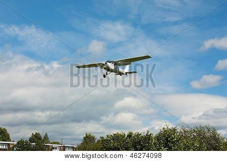 Small white airplane landing