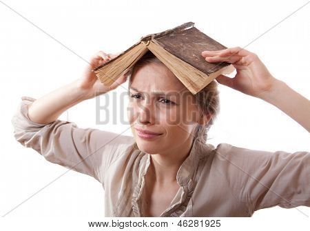girl with a book on her head, isolated on white
