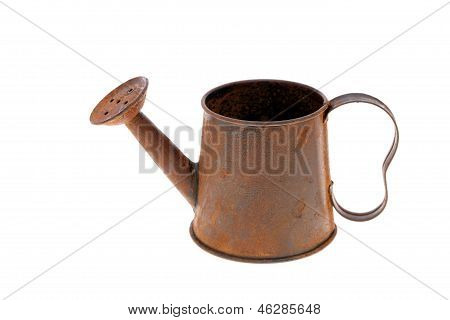 rusted miniature watering can