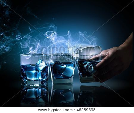Three glasses of blue cocktail