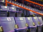 stock photo of bleachers  - Blue Folding Seats at an Indoor Sports Arena - JPG
