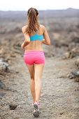 stock photo of crossed legs  - Trail runner woman running cross - JPG