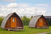 stock photo of peeing  - Modern camping tee pees at european camp site in The Yorkshire Dales National Park a contemporary trend called glamping because its more glamourous than the traditional method with all mod cons - JPG