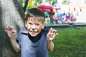 image of cute tiger  - Child with painted face - JPG