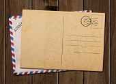 stock photo of old post office  - Old blank post card and envelope on wooden table - JPG