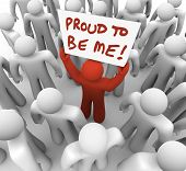 One unique or different person holds a sign in a crowd with the words Proud to Be Me to illustrate s