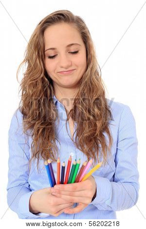 Portrait of an attractive young girl choosing a colored pencil. All on white background.
