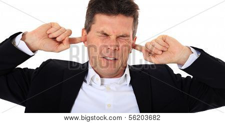 Attractive middle-aged man suffering from tinnitus. All on white background.