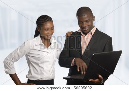 African Business Partner Work On Notebook