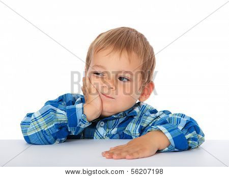 Cute caucasian boy looking bored. All on white background.