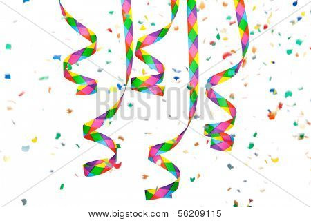 Colorful paper streamer and confetti. All on white background.
