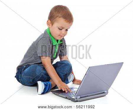 Cute little boy using laptop. All on white background.
