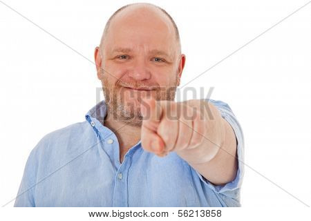 Charismatic middle aged man points with finger. All on white background.