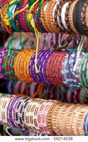 Fine wristbands offered at market stall