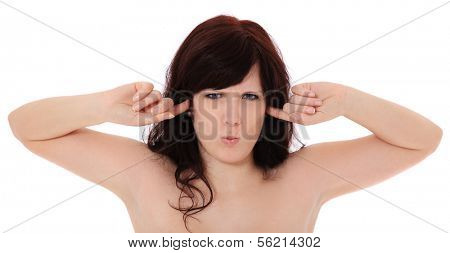 Attractive young woman keeps her ears shut. All on white background.
