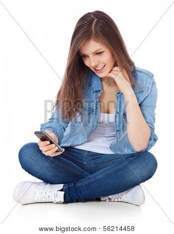 Attractive teenage girl using mobile phone. All on white background.
