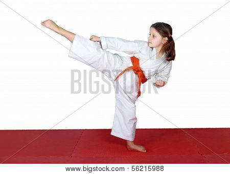 High leg kick in performed little athletes