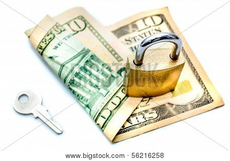 Key And Padlock Securing Dollar Note