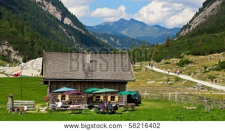 KRIMML, AUSTRIA - AUGUST 17, 2013: People resting at Veitn Alm in Krimmler Achental. The Veitn Alm is around 1460m above sea level with the Krimml waterfalls nearby being a famous tourist spot.