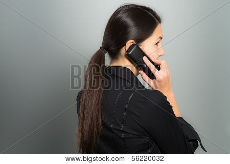 Secretive Businesswoman Talking On Her Mobile
